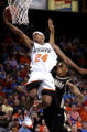 MOCS124 - Oklahoma State guard JamesOn Curry (24) goes up for a basket past the defenses of...