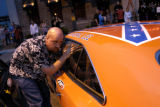 (DENVER, Colo., June 8, 2004) Travis Bell rolls up the windows of his Duke's of Hazard car at...
