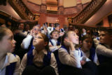 03/14/2005 - Denver, Colo. - Students from the Falcon Elementary School Choir wait on the steps...