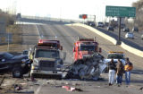 (NORTHGLENN, Colo., February 28,2005)   A burned up Northglenn Police car sits on northbound I-25,...