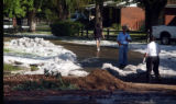 (lakewood, Colo., June 9, 2004)  A massive amount of hail  slowly melts on Willow Lane in Lakewood...