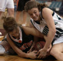 (Denver, CO., March 4, 2005)  Grand Junction's Jonell Devencenty, left, and ThunderRidge's Megan...