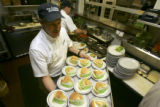 (LAKEWOOD, Colo., March 15, 2005) Owner and Chef Steve Modlich (cq) carries a tray of green lemon...