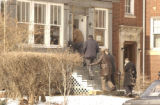 3-1-05, A man (not Chgo PD, brown coat) with a key walks up to open the door at the residence of...