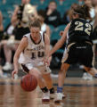 (Denver, CO., March 4, 2005)  Horizon's Kristi Smith (10) steals the ball from Arapahoe's Lindsay...