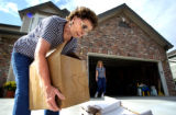 (LITTLETON, Colo., June 8, 2004)    Freda Poundstone (left) of Castle Pines North loads boxes of...