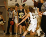 Thorton, Colo., photo taken March 2, 2005- Monarch's, Mali Hansen (#40 black jersey), burst into...