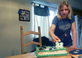(FOUNTAIN, Colo., March 11, 2005)  Melissa Givens, 28, lights the candles on the birthday cake for...