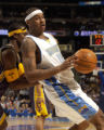 (Denver, CO., March 3, 2005)  Carmelo Anthony backs up against the Pacers'  Stephen Jackson under...