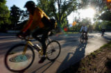 (DENVER, Colo., June 23, 2004) Cyclist make their way along Speer Blvd., on the Cherry Creek bike...