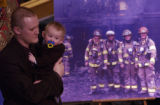 (AURORA, Colo., February 18, 2005) Jonathon and his son James, 1, speak of the father/grandfather...