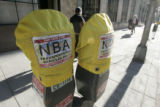 ( DENVER-2-17-2005 )  Parking meters bagged for NBA transportation use on Stout Street in downtown...