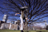 (DENVER, Co. - SHOT 3/16/2005) Daniel Roach, 23, of Aurora plays hacky sack under an old tree in...