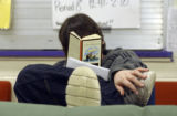 (LITTLETON, Colo., March 3, 2005) Zach (cq Zach from subject) Parker tackles an in class reading...