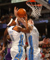 Denver, Colo., photo taken March 20, 2005- Denver Nuggets, Carmelo Anthony (cq left #15) and...