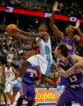Denver, Colo., photo taken March 13, 2005- Denver Nugget guard, Earl Boykins (cq left white jersey...
