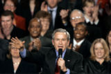 (DENVER shot on 3/21/05)   President George W. Bush makes a point to the cheers of the crowd at...