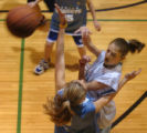 (DENVER, COLORADO:  FEBRUARY 15, 2005)  Julia Porter, 12, (cq Julia Porter) top, passes the ball...