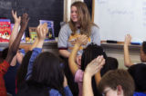 (DENVER, Colo., March 9, 2005) 2nd graders at Rosedale Elementary raise their hands to ask student...