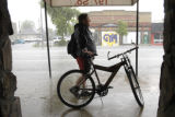 (DENVER, Colo., June 9, 2003)Greg Tamayo takes shelter under an awning in Denver near Broadway and...