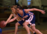 (Pueblo, CO., March 10, 2005)  North Park's Tianna Hartman, left, and Hi-Plains' Julia Borges,...