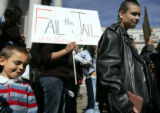 03/10/2005 Denver-Jose Vallez, 5, left, joins others in a demonstration against the proposed...