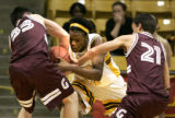 (Boulder shot on 3/10/05) (4A) Thomas Jeferson High School's#34 Pierre Allen(center) fights for...