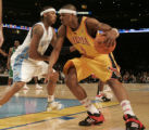 (Denver 02/18/2005) ---- Denver Nuggets Carmelo Anthony, left, defends Atlanta Hawks Josh Smith in...