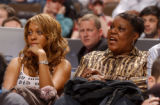Denver, Colo., photo taken February 18, 2005- Carmelo Anthony's fiance, La La Vazquez (left), sits...