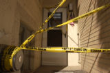 (DENVER, Colo., February 19, 2005) Police tape covers the door of apartment #4 at 1057 Marion St....