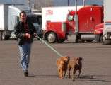 (DENVER Colo., February 20, 2005) Bill Scribner leads his dog Reilly (center) and his late good...