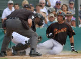 XTC105 - Home Plate umpire Peter Durfee, left, watches as Colorado Rockies catcher Charles...