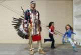 (Loveland, Colo., April 11, 2004) Mike Azure, left, of Poplar Montana, watches the other Pow-wow...