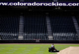 (DENVER, Co. - SHOT 3/30/2005) Coors Field groundskeeper James Sawl, 34, mows the outfield along...