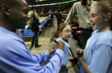 (DENVER, Colo., March 16, 2005)  Earl Boykins, left, jokes around with Alex Lean, 11, right, while...