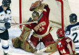 10 APR 2004:  Adam Berkhoel (24) of Denver University makes a save against Maine University in the...