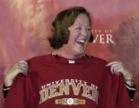 (DENVER, CO., March 28, 2005) Margaret Bradley-Doppes holds a  DU sweatshirt presented to her by...