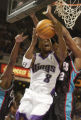Sacramento Kings Anthony Peeler, drives in for a shot in front of Lorenzwn Wright, during their...