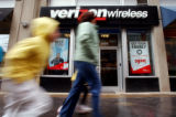 (DENVER, CO. MARCH 29, 20005) People walk past the Verizon Wireless store in downtown Denver...