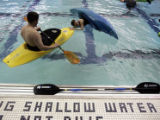 ( DENVER-3/15/2005 )  Novice kayaker Janet Hirsh (cq), right,  practices rolling during a clinic...