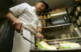 (LAKEWOOD, Colo., March 15, 2005) Owner and Chef Steve Modlich (cq) cuts green lemon meringue pies...