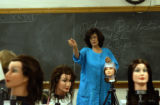 (DENVER, Colo., October 6, 2004) Sharon Salvo, teacher, points out details of a student working on...