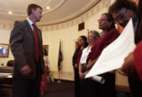 (Denver, Colo., October 7, 2004) Mayor John Hickenlooper, left, talks with Red Earth Women's...