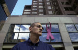 (DENVER, Colo., Weds. Oct. 21, 2004)  Qwest employee Issac Hernandez stands in front the Qwest...