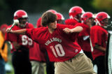 (DENVER, Co., SHOT 9/28/2004) Brad Sims, 16, winds up to beat a drum on the sidelines that aids...