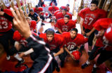 (DENVER, Co., SHOT 9/28/2004) Colorado School of the Deaf and Blind football players watch the...