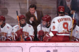 Denver, Colo., photo taken October 22, 2004- Denver Hockey coach, George Gwozdecky (center in...