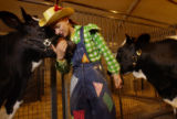 "Denver, Co.  10/7/04   Christine Winn hugs one of her cows, named ""Poo-Poo"" while..."