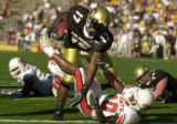Boulder, Colo., photo taken October 9, 2004- University of Colorado running back Lawrence Vickers...