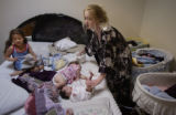 Denver, Colorado.  March 31 and april 1. Triplets.  Linda Bateman changes Arianna's diaper, (one...